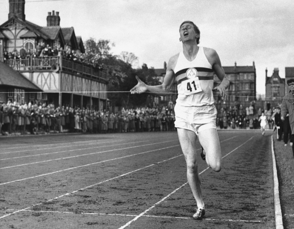 British athlete Roger Bannister breaks the tape to become the first man ever to break the 4-minute barrier in the mile at Iffly Field in Oxford, England, on May 6, 1954.