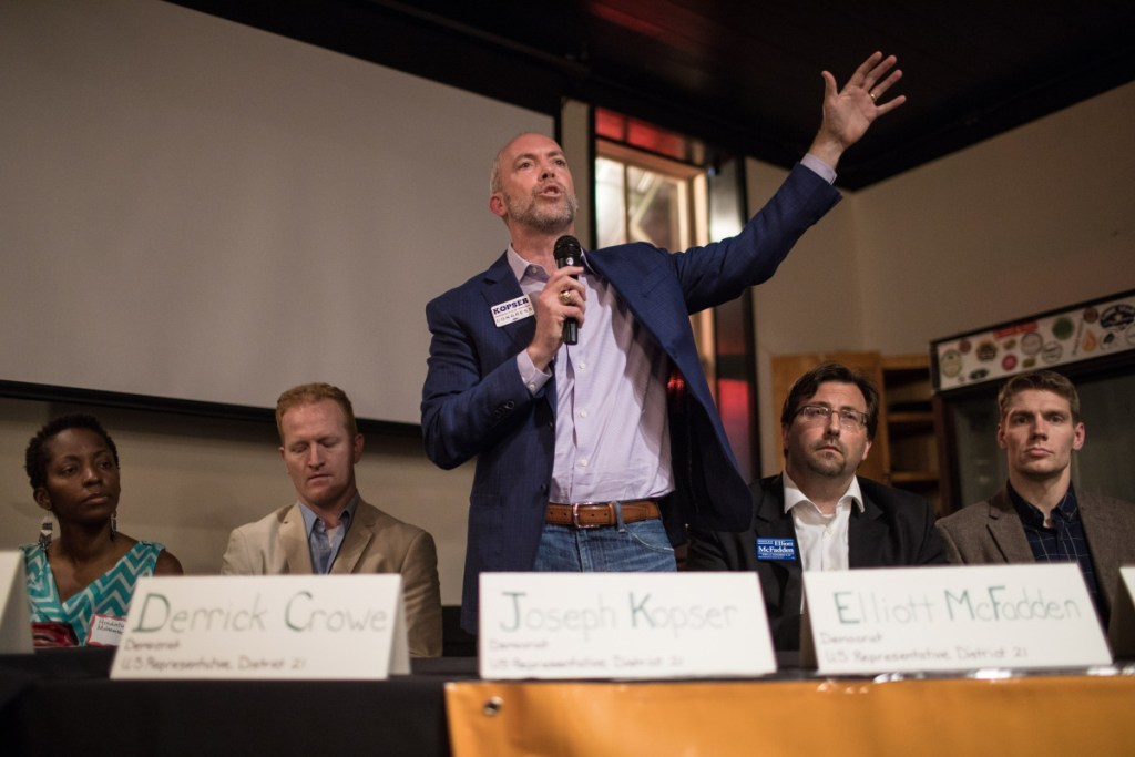 Joseph Kopser, a candidate for Texas' 21st District seat, speaks at a forum focused on environmental issues at Scholz Garten in Austin.