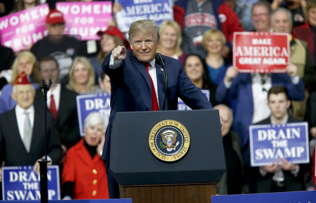 President Trump reacts to the crowd while speaking at a campaign rally for Republican House candidate Rick Saccone in a hangar Saturday in Moon Township, Pa.
