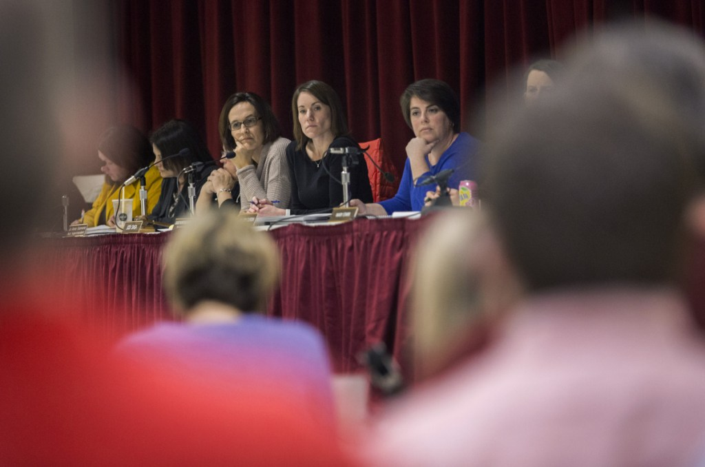 """Scarborough Superintendent Julie Kukenberger, center, listens with board members Jodi Shea, left, and Hillary Durgin, right, as parents and school administrators voice their opinions during a meeting March 12 to discuss later school start times. The teachers' union has taken a vote of """"no confidence"""" in the school board and superintendent."""