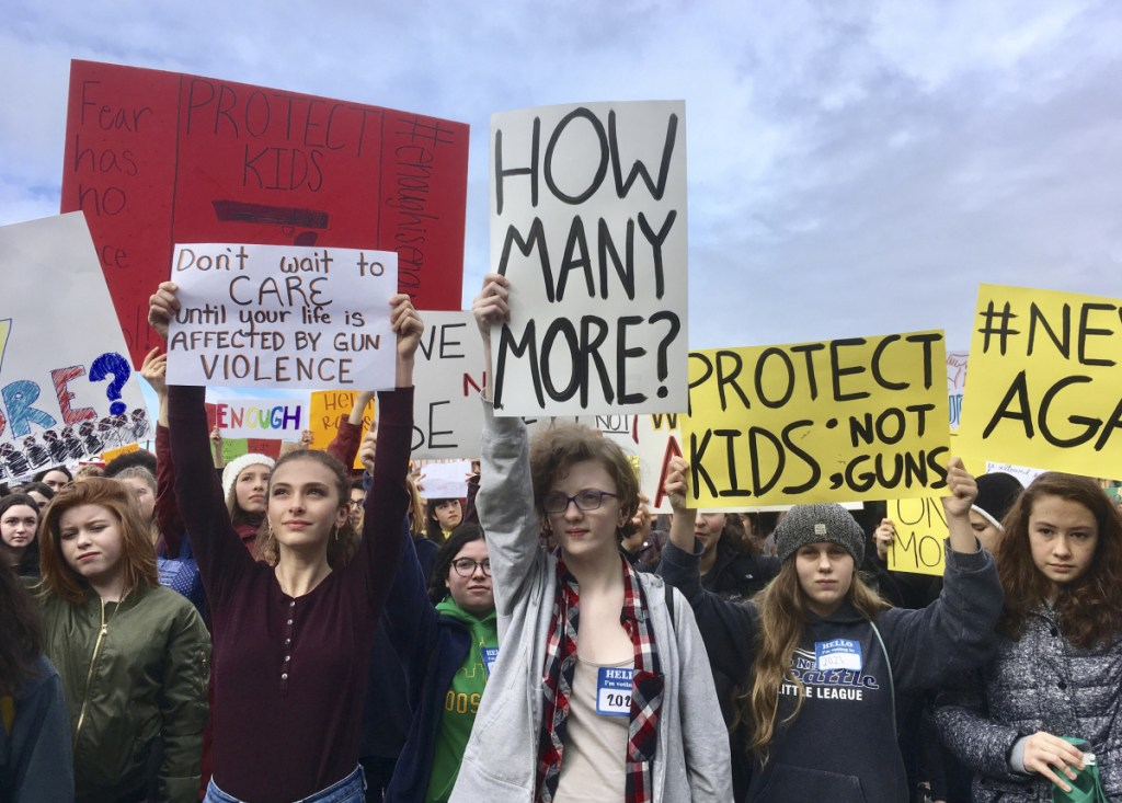 Students at Roosevelt High School take part in a protest against gun violence Wednesday in Seattle. It was part of a nationwide school walkout that calls for stricter gun laws following the massacre of 17 people at a Florida high school.