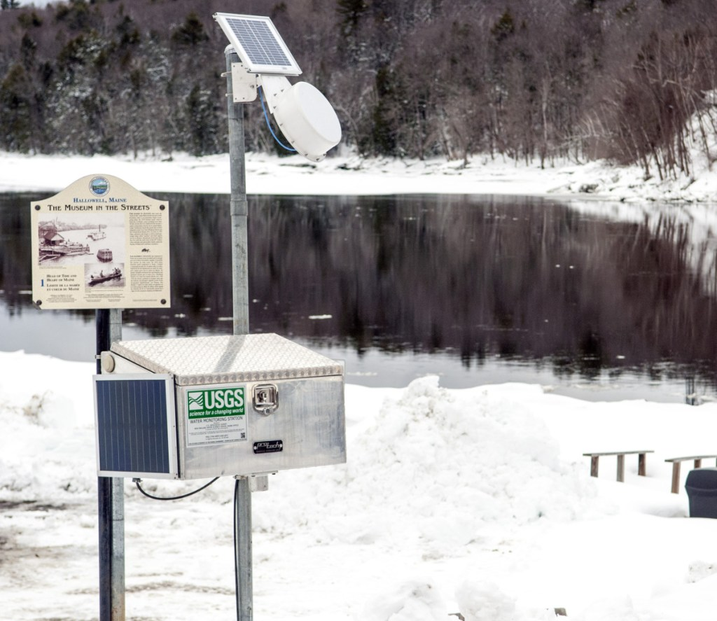 The U.S. Geological Survey installed a water monitoring station in Hallowell's Granite City Park on the banks of the Kennebec River. Officials say colder-than-normal temperatures increase the likelihood of a quick ice melt.