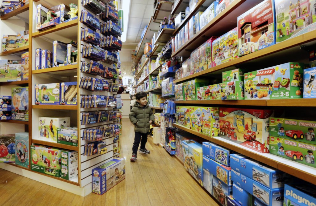 A young customer checks out the merchandise at Mary Arnold Toys in Manhattan's Upper East Side. Mary Arnold, a nearly 90-year-old store, is thriving along with many other small and independent toy stores.