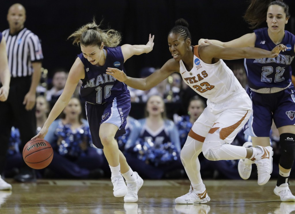 University of Maine guard Julie Brosseau moves the ball upcourt past Texas' Ariel Atkins during an NCAA tournament first-round game in Austin, Texas, on March 17. (AP Photo/Eric Gay)