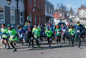 RUNNERS HEAD OUT for the Shamrock 5K road race held on Saturday in Bath. Blustery, cold conditions greeted the runners for the ninth annual event.