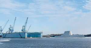THE FUTURE USS MICHAEL MONSOOR, one of three Zumwalt-class stealth destroyers built at Bath Iron Works, passes the shipyard's floating drydock on its way to sea trials in January. A proposed $45 million tax credit benefiting the General Dynamics-owned facility has passed the Maine Senate and returns to the House.