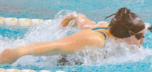 TALIA JORGENSEN races for the LRSC in the 100-yard butterfly in the girls 13-and-over division.
