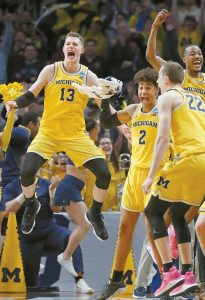 MICHIGAN forward Moritz Wagner (13), guard Jordan Poole (2), guard Muhammad-Ali Abdur-Rahkman, top left, and guard Duncan Robinson (22) celebrate during the second half of the team's NCAA men's college basketball tournament regional semifinal against Texas A&M on Thursday in Los Angeles.