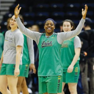 NOTRE DAME'S Arike Ogunbowale smiles as she walks on to the court before a practice session for the women's NCAA Final Four college basketball tournament on Thursday in Columbus, Ohio. Notre Dame plays Connecticut tonight, with tip-off slated for 9:30 p.m.