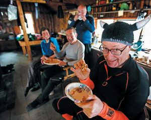 BACKCOUNTRY SKIER Bill Cunningham of Pittsfield shows off his knitted Viking cap during a snack break in the Haskell Hut in the Katahdin Woods and Waters National Monument in northern Maine earlier this month. Cunningham and his fellow members of the Penobscot Valley Ski Club were getting in the spirit for an upcoming ski trip to Norway.