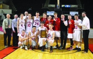 The Wells High School boys basketball team celebrates with the Class B South regional championship last weekend. The Warriors will look to add a Gold Ball to their trophy case when they face Hermon tonight in the state finals. ALEX SPONSELLER/Journal Tribune