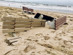 Public benches along the beach at Old Orchard Beach are knocked over and partially buried under sand on Wednesday after last week's nor'easter. More damage could result from the storm expected to begin Wednesday and continue today. LIZ GOTTHELF/Journal Tribune