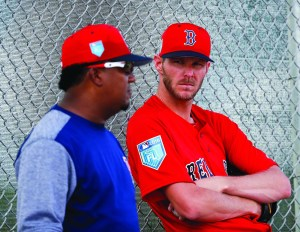 Boston Red Sox starting pitcher Chris Sale, right, listens to former Red Sox hall of famer Pedro Martinez during baseball spring training, Wednesday, Feb. 14, 2018, in Fort Myers, Fla. AP NEWSWIRE