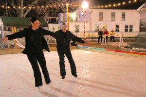 Sanford skaters Paula Allaire and her father, Ray Charpentier delighted the crowd at the Sanford 250th birthday kick-off celebration in Central Park Tuesday night.  TAMMY WELLS/Journal Tribune
