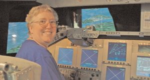 SHARON EGGLESTON, a retired senior project engineer for Lockheed Martin, in NASA's space shuttle simulator at the Johnson Space Center.