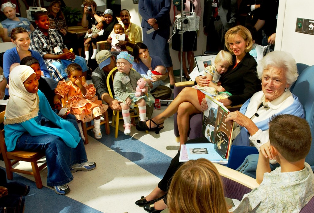 Barbara Bush reads to a group of children patients at Barbara Bush Children's Hospital in Portland during a visit by the former first lady in September 2003, when it was announced that the hospital planned a large addition.