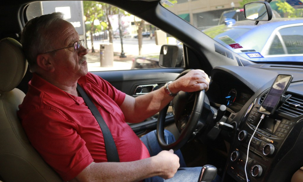 Uber driver Johnny Pollard of Haltom City, Texas, says he grosses $1,200 to $1,800 per week with his car and a mileage tracker, left, shuttling customers around the Dallas-Fort Worth region. The former truck driver says his freelance job saved him from the unemployment line.