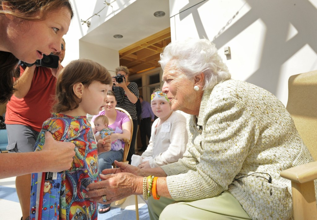 Barbara Bush visits and reads a story to patients at the Barbara Bush Children's Hospital at Maine Medical Center in Portland in 2013. The hospital is the best-known testament to the generosity of the former first lady toward the state where she spent 74 summers.