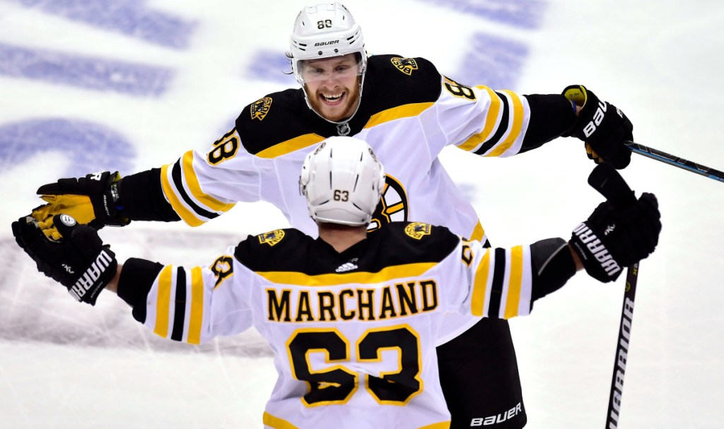 Brad Marchand celebrates with teammate David Pastrnak after scoring a goal in the second period against the Toronto Maple Leafs on Thursday in Toronto in Game 4 of their first-round playoff series. Boston won 3-1 and has a 3-1 lead in the series.
