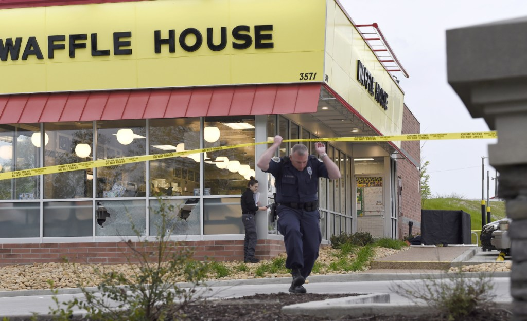 Police work the scene of a fatal shooting at a Waffle House in the Antioch neighborhood of Nashville on Sunday.