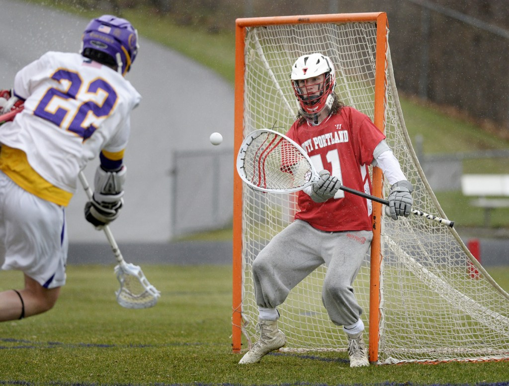 South Portland goalie Quinn Watson is in position to stop a shot by Chris St. John of Cheverus. Watson finished with 10 saves, and St. John scored once.