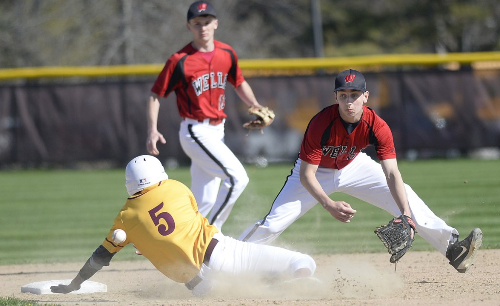 Valentin Murphy of Cape Elizabeth slides safely into second with a stolen base Friday as Gary Andrews of Wells covers the bag.Backing up the play is Liam Bell. Wells scored four runs in the seventh inning to overtake the Capers for an 8-6 victory.