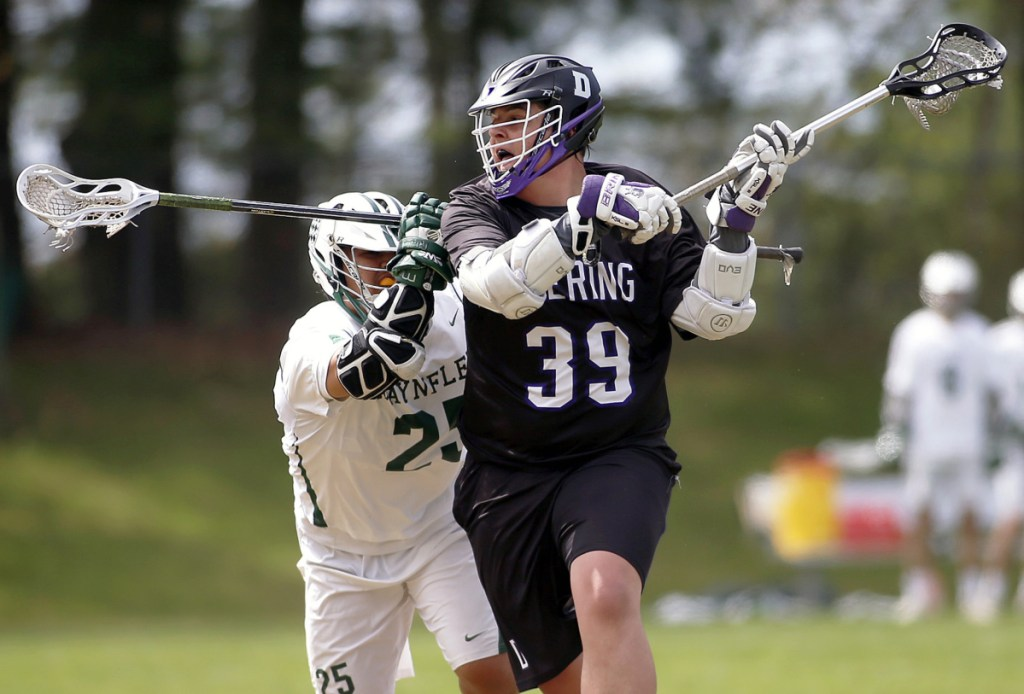 Deering's Payson Harvey winds up for a shot while defended by Makany Parr of Waynflete. Harvey scored three goals, but Waynflete rallied for a 12-11 win.
