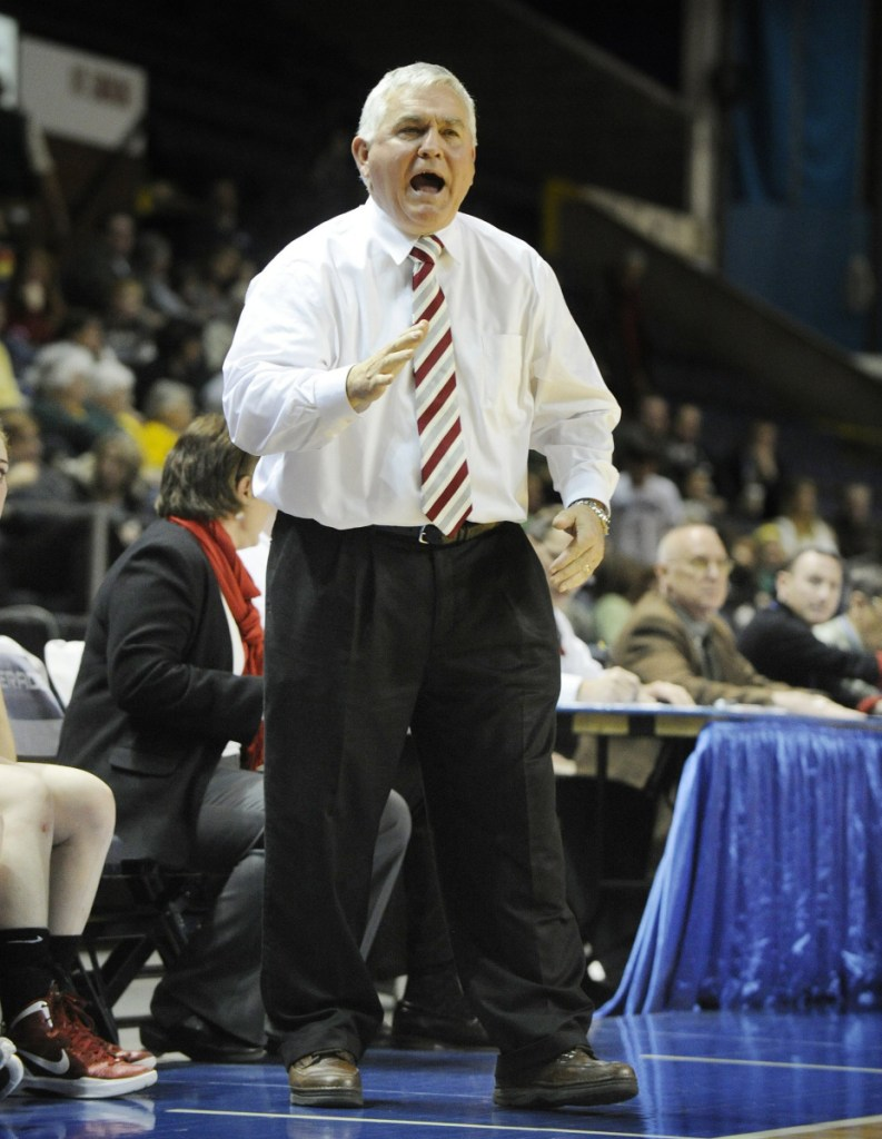 Tom Maines shouts out instructions while coaching the Scarborough girls' team during the 2012 state basketball tournament. (Staff Photo by John Ewing)