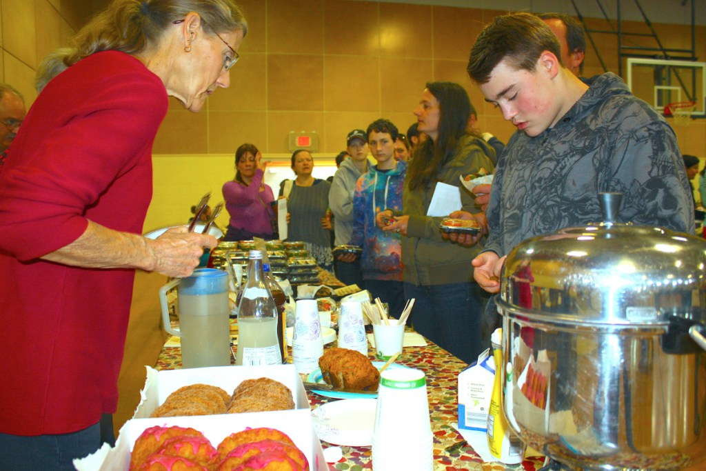 People line up for vegan doughnuts and coffee at the 2017 Veg Fest in Portland. This year's event takes place June 2 at the East End Community School.