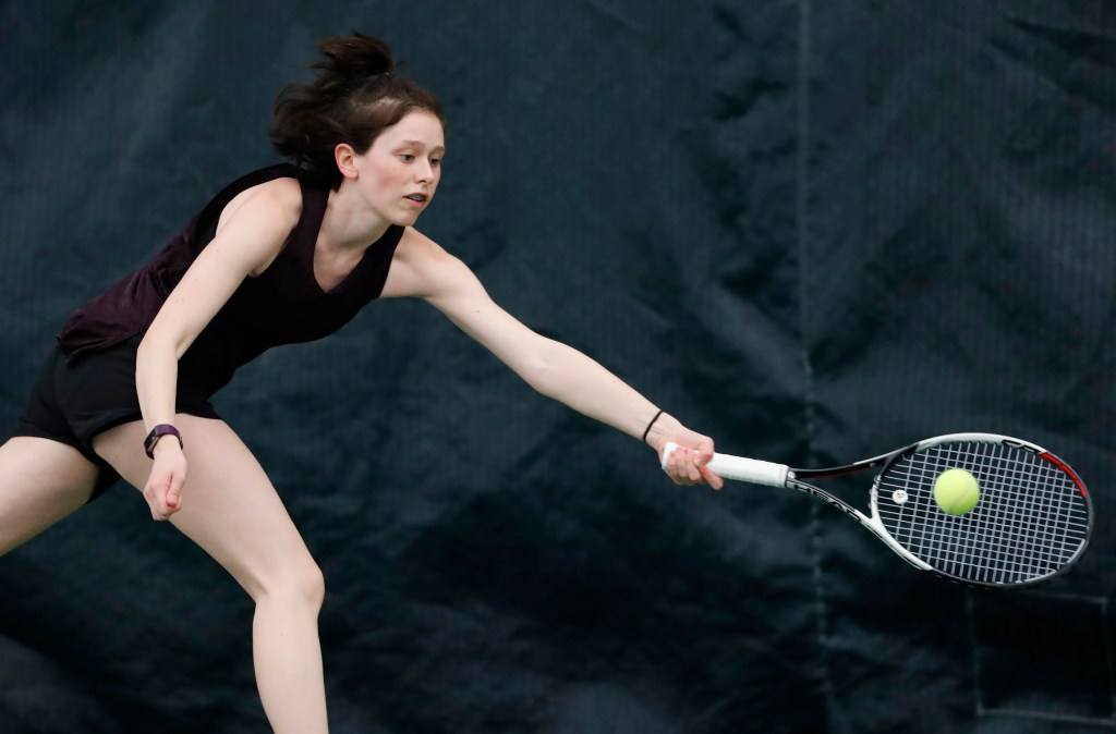 PORTLAND, ME - MAY 28: Grace Campanella stretches to return a shot as she plays her sister in the state singles tournament Monday, May 28, 2018 in Portland, Maine. (Staff Photo by Joel Page/Staff Photographer)