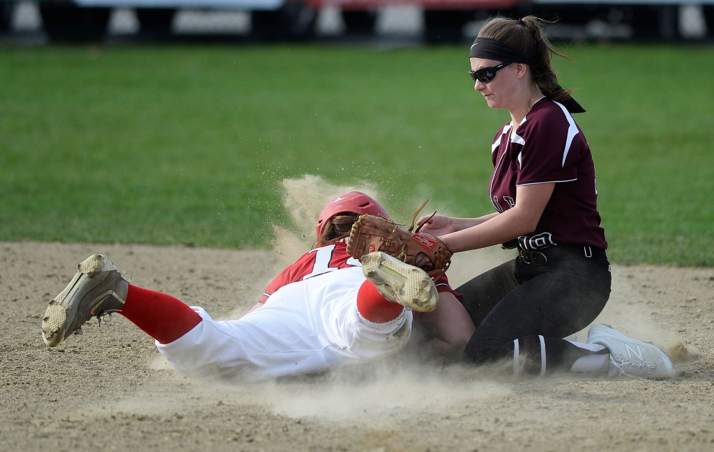 Scarborough's Sam Carreiro dives safely into second base under the tag of Noble's Lauren Sanger for a stolen base.
