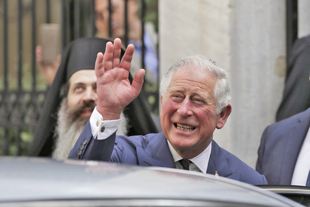 """Britain's Prince Charles leaves a meeting with the head of Greece's Orthodox Church, Archbishop Ieronymos, in Athens, on May 10, 2018.  """"Pleased to be able to welcome Ms. Markle to the Royal Family in this way."""""""
