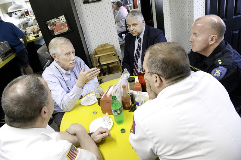 U.S. Sen. Angus King, second from left, has lunch Tuesday with, counterclockwise from lower left: Lewiston Fire Chief Brian Stockdale, Auburn Fire Chief Robert Chase, Lewiston Police Chief Brian O'Malley and Auburn Police Chief Phil Crowell at Simones' Hot Dog Stand in Lewiston.