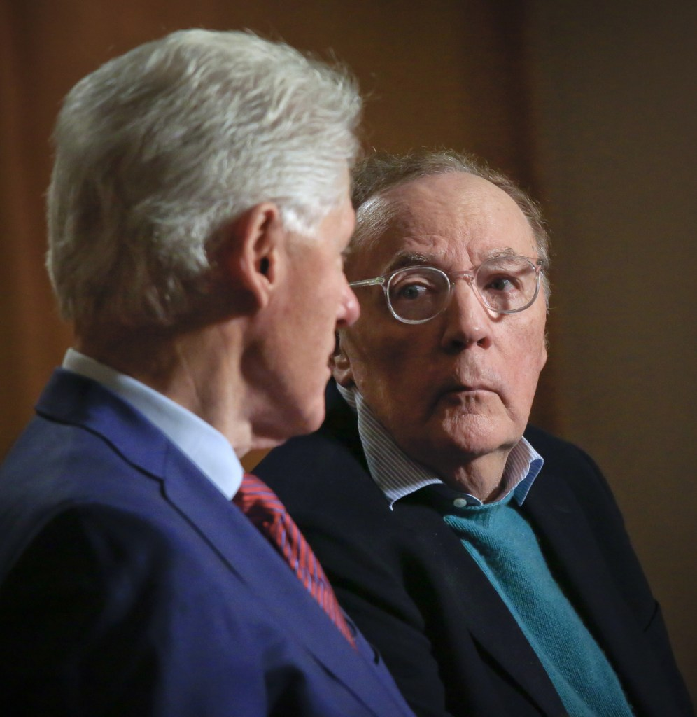 Former President Bill Clinton, left, and author James Patterson speak during an interview about their new novel.