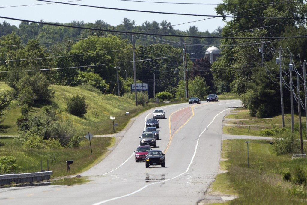 A truck passes several cars on Route 4 in Berwick on Sunday, close to where Saturday's fatal accident happened.