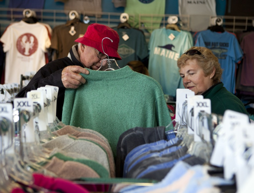 Bert and Dianne Shuey of Landisburg, Pa., peruse the shirts and sweatshirts at The Blue Lobster on Commercial Street on May 13, when three cruise ships docked in Portland.
