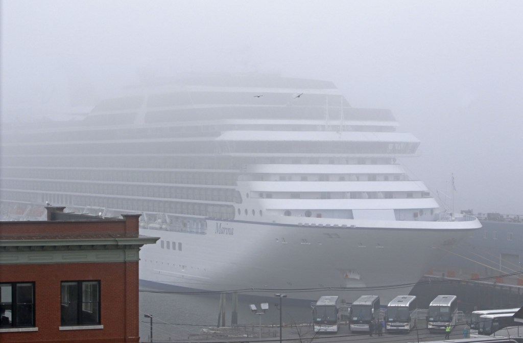 The cruise ship Marina is enshrouded in fog during an April stop in Portland with 1,171 passengers and 800 crew members. Although a 2009 study overestimated passenger spending in Portland, the cruise industry really does bring net economic benefits to the city.