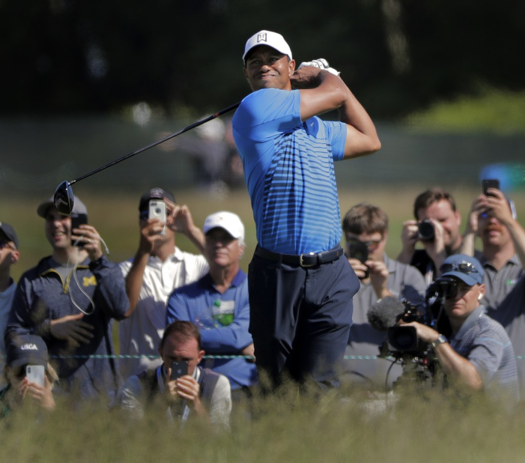 Tiger Woods tees off on the 8th hole during a practice round for the U.S. Open on Tuesday in Southampton, N.Y. Woods is back at the U.S. Open for the first time in three years and is hoping to contend.