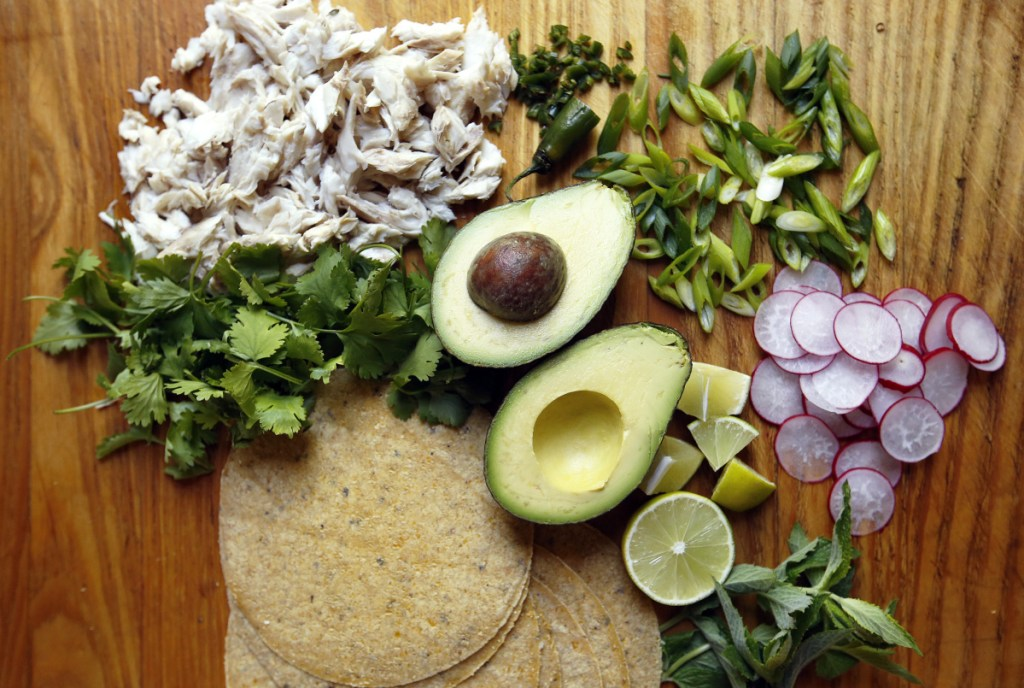 """Ingredients for this salpicon – Spanish for """"hodgepodge"""" – include leftover fish and avocado, radishes, herbs and scallions."""