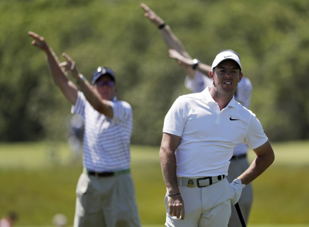 Associated Press/Julio Cortez   Rory McIlroy of Northern Ireland watches his approach shot from the rough on the third hole during the first round of the U.S. Open Golf Championship on Thursday in Southampton, N.Y.