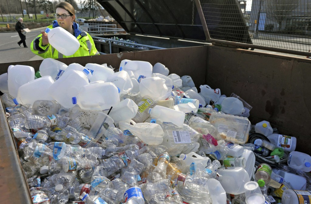 Margo Gillaspy displays some of the recyclable plastic items that had been deposited at a transfer station in Mt. Vernon, Wash.