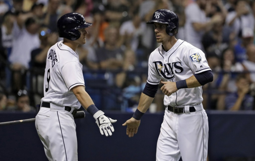 Tampa Bay's Matt Duffy, right, celebrates with Jake Bauers after scoring on a sacrifice fly by C.J. Cron in the fifth inning Friday night.