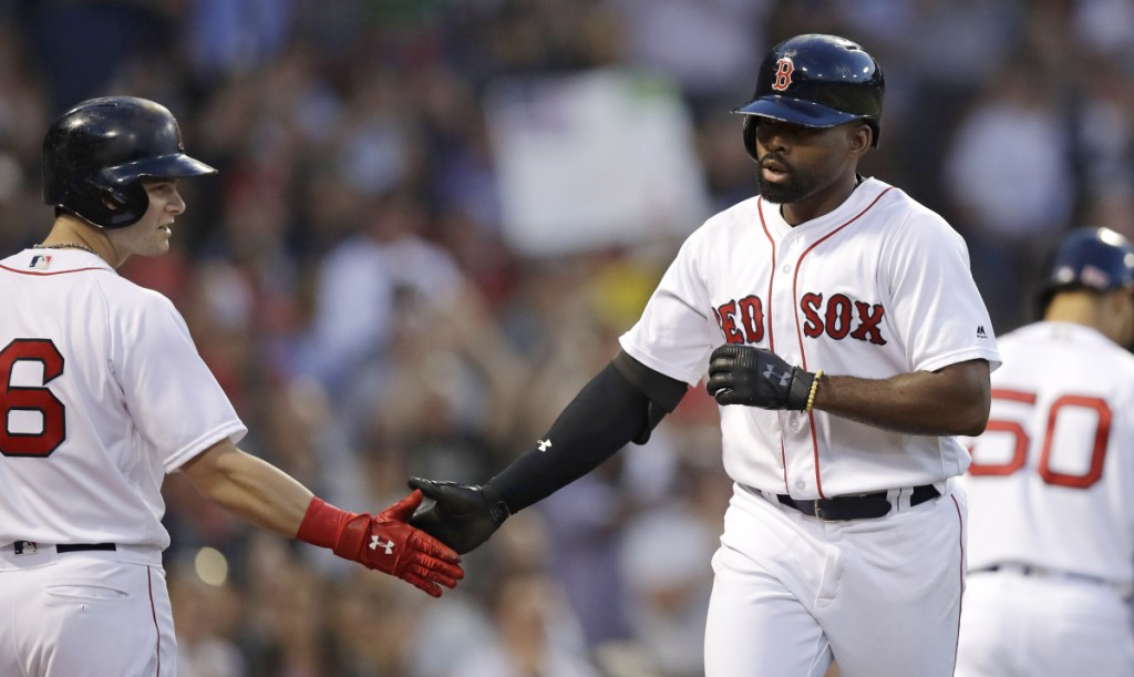 Boston's Jackie Bradley Jr., right, is congratulated by Andrew Benintendi after his solo home run in the third inning Tuesday night at Fenway Park.