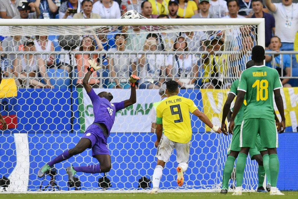 A shot by Colombia's Yerry Mina eludes Senegal goalkeeper Khadim Ndiaye for the only goal Thursday in Colombia's 1-0 victory that eliminated Senegal from the World Cup.