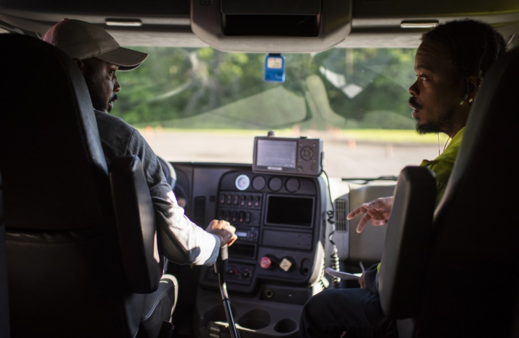 TDDS Technical Institute in central Ohio is training new truck drivers for an industry desperate for recruits. Dione Valentine, left, and Amos Moore get a hands-on lesson at TDDS as they work for their commercial driver's licenses.
