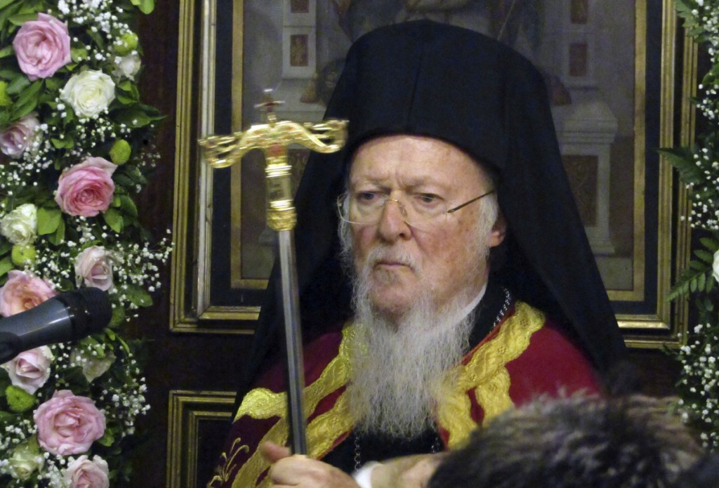 Ecumenical Patriarch Bartholomew takes part in a service at the church of saint Nicholas on the island of Spetses, Greece, on Wednesday. The spiritual leader of the world's Orthodox Christians hosted an environmental conference to seek backing from other religious leaders in a global campaign to take action against climate change.