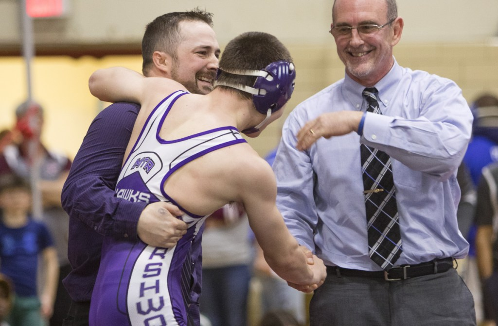 SANFORD, ME - FEBRUARY 17: Marshwood 126 lb wrestler Liam Coomey celebrates a victory over Noble's Sam Martel with coaches Pat Howard and Matt Nix during the Class A state wrestling championship in Sanford, on Saturday, February 17, 2018. (Photo by Carl D. Walsh/Staff Photographer)