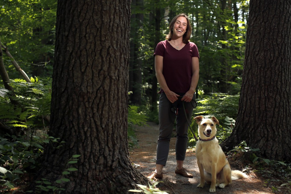 Betsy Cook with her dog Banjo in Canco Woods.