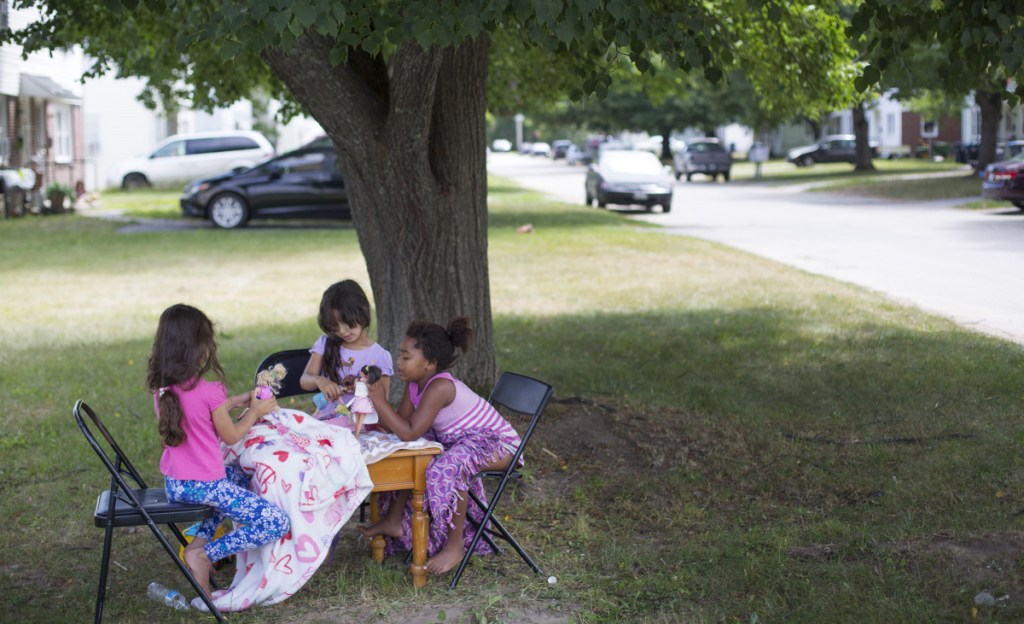 Neighborhood girls play with dolls in a yard at Sagamore Village in Portland, near the proposed site of a new homeless service center. About 80 percent of Nason's Corner's 3,580 residents are homeowners, according to 2015 Census data.