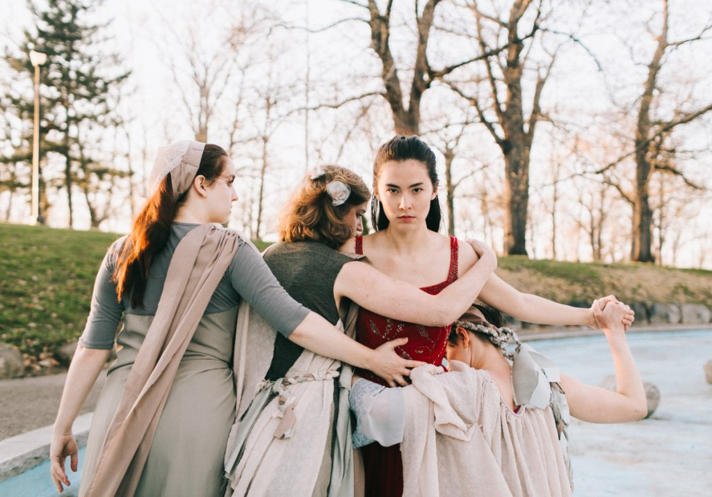 Erica Murphy, in red, as Eurydice, with Hannah Daly, left, Casey Turner and Ella Mock as the three stones.